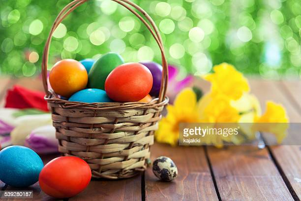 colored easter eggs in basket - easter egg stock pictures, royalty-free photos & images