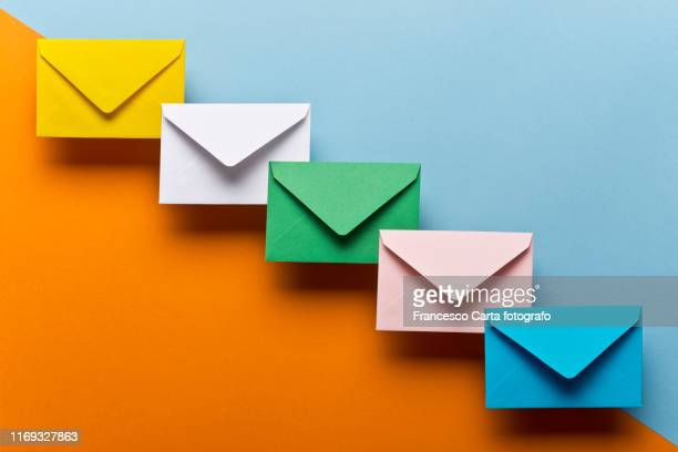 colored envelopes - message stock pictures, royalty-free photos & images