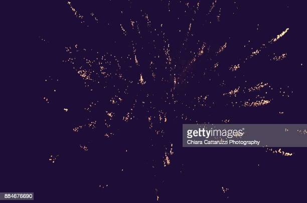 colored fireworks by night - epiphany stock photos and pictures