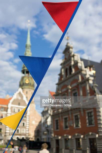 Colored Flags On The Background Of The House Of The Blackheads A