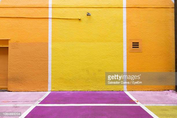 colored floor and wall of building - multi coloured stock pictures, royalty-free photos & images