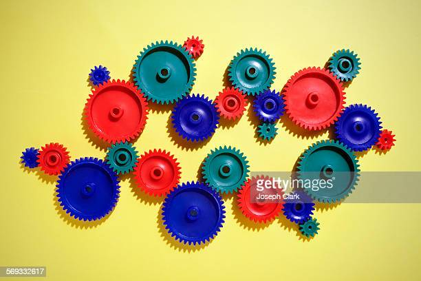 colored gears - gear stock pictures, royalty-free photos & images