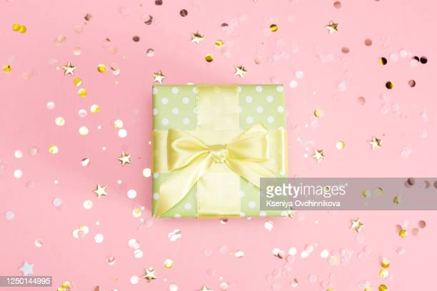 colored gift boxes with colorful ribbons. white background. gifts for christmas or a birthday. - aniversario fotografías e imágenes de stock