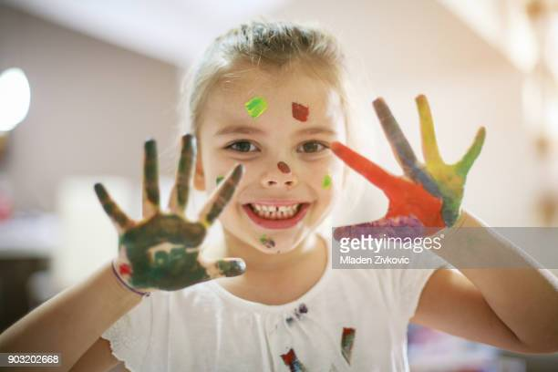 colored hands. - 4 girls finger painting stock photos and pictures