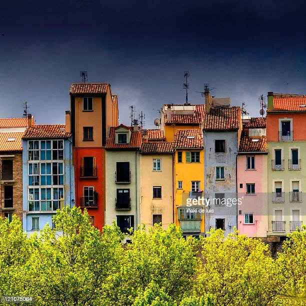 colored houses of paseo de ronda street - pamplona stock photos and pictures