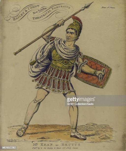 Colored illustration depicting a fulllength view of British actor Edmund Kean as Brutus with an angry expression on his face holding a spear in one...