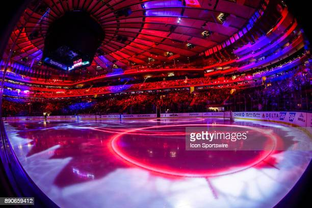 Colored lights illuminate Madison Square Garden ice during break from the Dallas Stars and New York Rangers NHL game on December 11 at Madison Square...