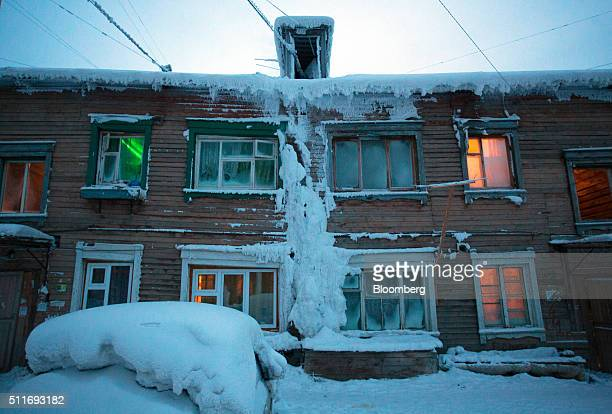 Colored lights illuminate the interior of wooden residential homes covered in ice in Yakutsk Sakha Republic Russia on Wednesday Feb 17 2016 Yakutsk...