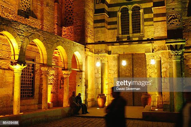 Colored lights illuminate the Mamluk 13th century complex of alMansur Qalawun at night on February 25 2009 in Cairo Egypt Despite being known...