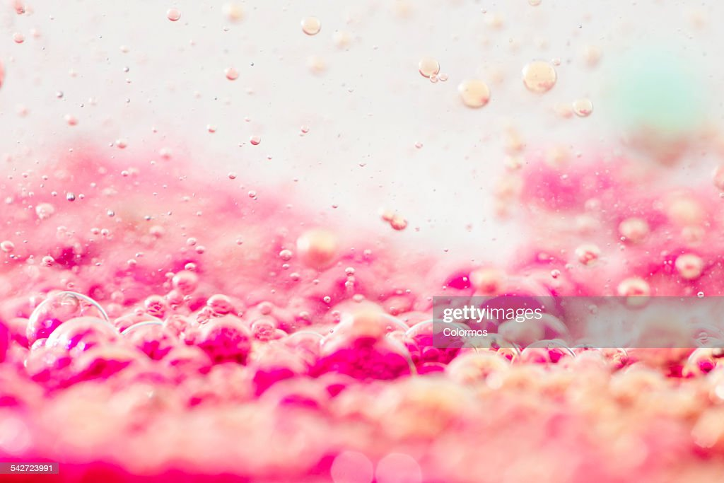 Colored liquids with bubbles, close-up : Stock Photo