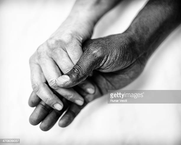 A colored man and a white female holding hands