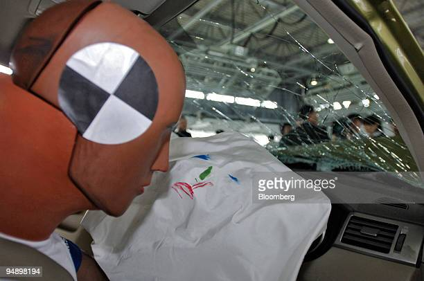Colored marks indicate where a crash test dummy's face struck an airbag in a Nissan Tiida sedan following a collision test at the Nissan Advanced...