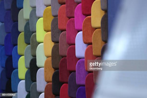 Colored material made from Alcantara SpA fabric sit on display at the Aircraft Interiors Expo in Hamburg, Germany, on Tuesday, April 4, 2017....