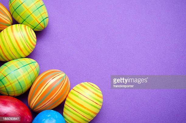 Colored Painted easter egg on purple background