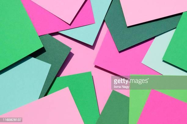 colored paper sheets - mehrschichtig stock-fotos und bilder