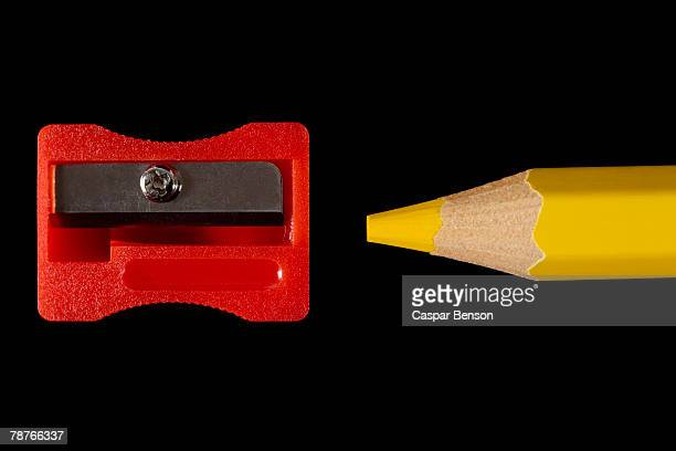 A colored pencil and sharpener