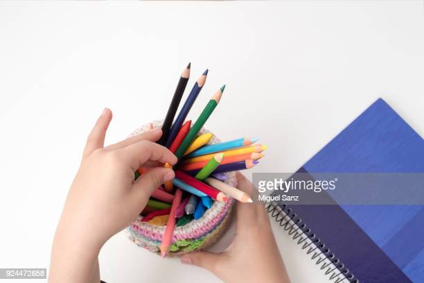 colored pencils and notebook paper - workbook stock photos and pictures