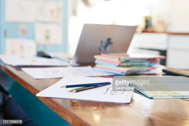 colored pencils and school books on dining table - education stock pictures, royalty-free photos & images