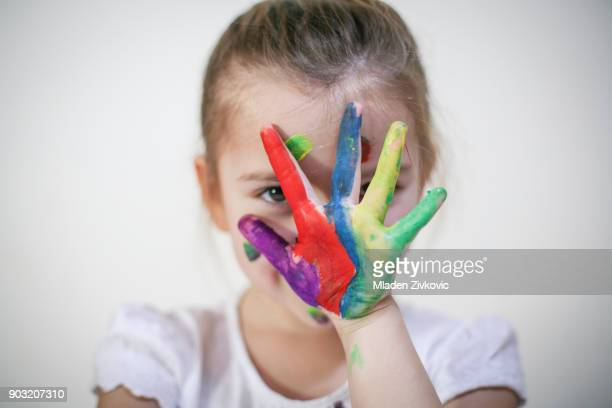 colored. - 4 girls finger painting stock photos and pictures