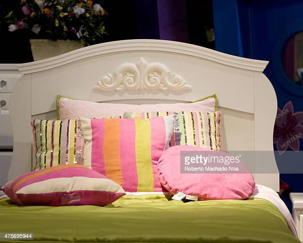Colored pillows lie on the bed Elegant bedroom with white bed