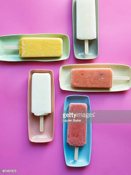 Colored Popsicles on Pink Background