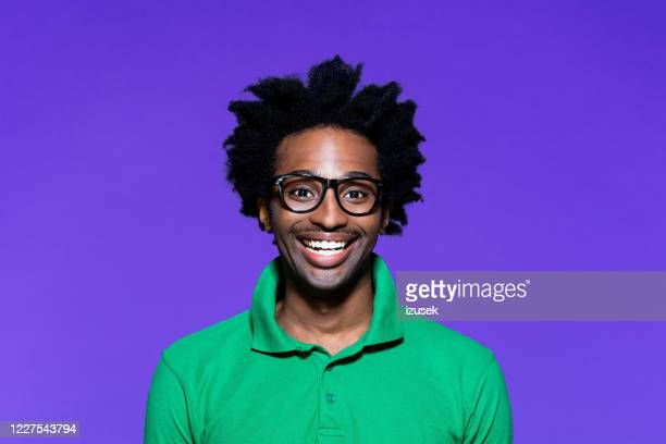 colored portrait of excited young man with dreadkocks looking away - personal accessory stock pictures, royalty-free photos & images