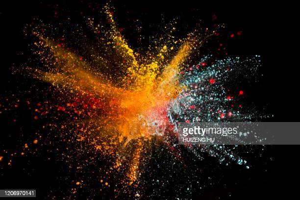 colored powder explosion on black - 爆発物 ストックフォトと画像