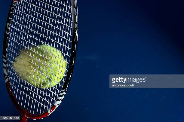 colored powdered tennis ball hitting tennis racket - ラケット ストックフォトと画像