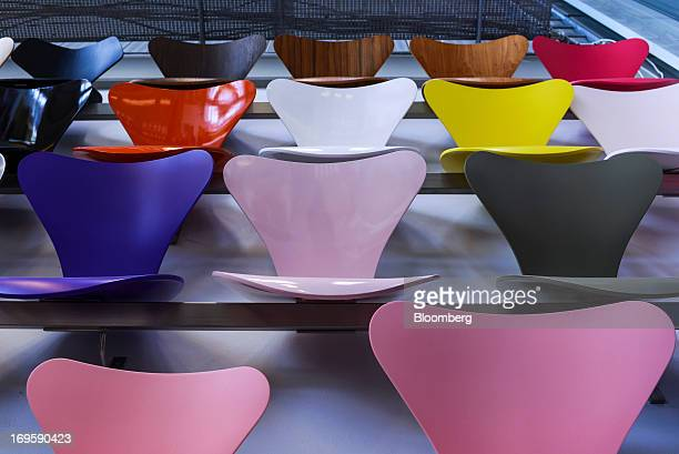 Colored seat backs from the 'Seven' 'Ant' and 'Lily' chair range designed by Arne Jacobsen sit on display during quality control at the Fritz Hansen...