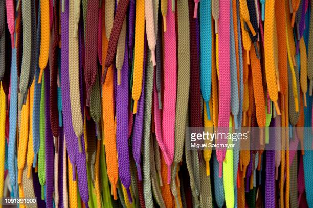 colored shoes laces - shoelace stock pictures, royalty-free photos & images