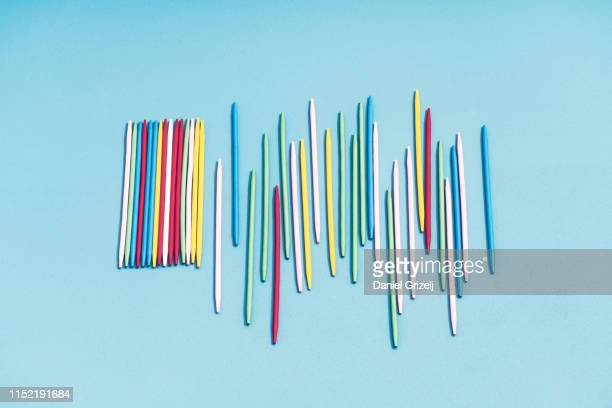 Colored sticks placed in the beginning as a line in order, then turns to chaos