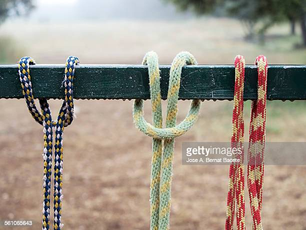 Colored strings tied on a fence