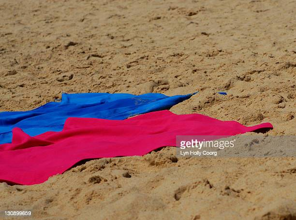 colored towels on sandy beach - lyn holly coorg stock pictures, royalty-free photos & images