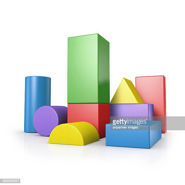 Colored towers of building blocks on white