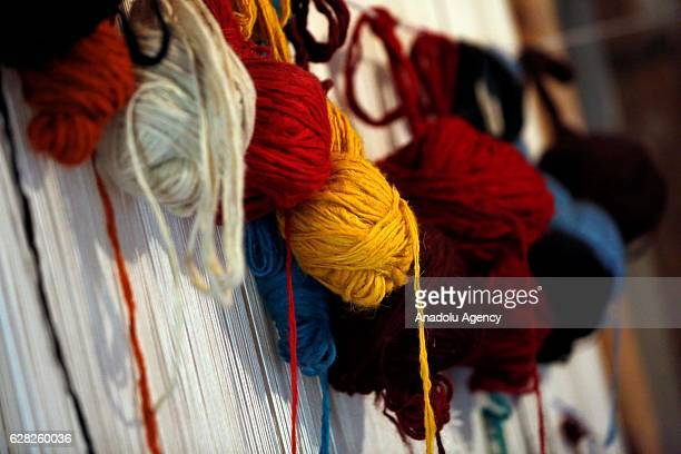 Colored yarns are seen at a carpet weaving workshop at Al Fakeha Village of Beqaa Lebanon on November 30 2016 Carpet weaving craft that exapand in...