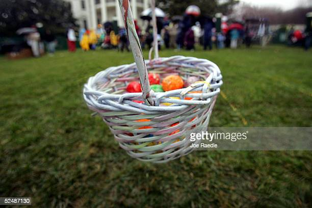Colorerd eggs sit in a basket for children to use during the Easter Egg roll March 28 2005 on the White House's South Lawn in Washington DC Kids of...