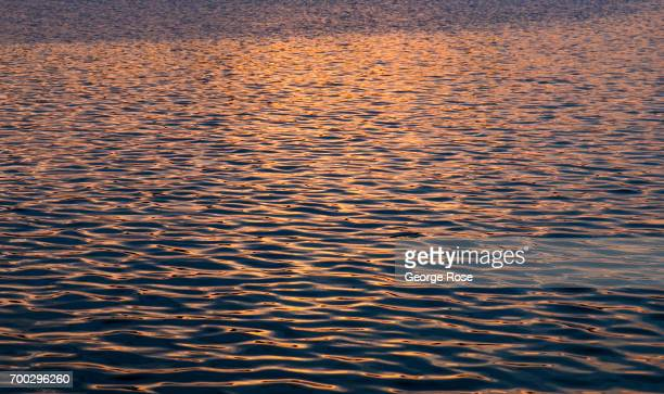 A colorfu sunset along the Potomac River is viewed on June 4 2017 in Washington DC The nation's capital the sixth largest metropolitan area in the...
