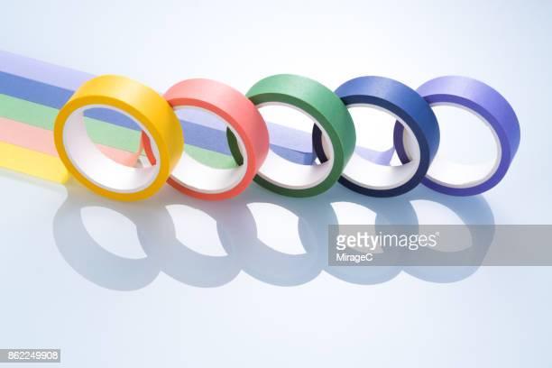 colorful adhesive tapes on white glass - cinco objetos - fotografias e filmes do acervo