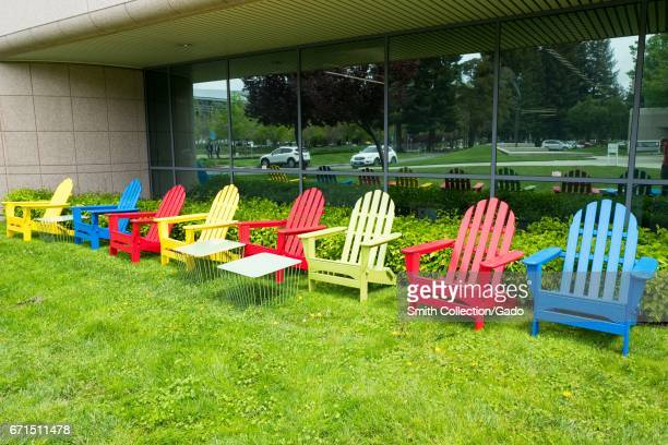 Colorful Adirondack chairs in Google Inc brand colors at the Googleplex headquarters of Google Inc in the Silicon Valley town of Mountain View...