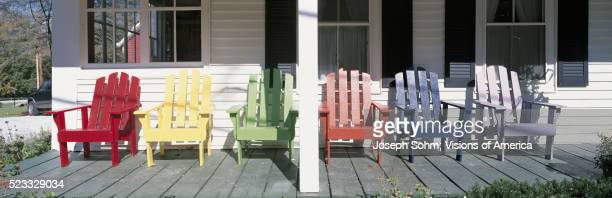 Colorful Adirondack Chairs on House Porch