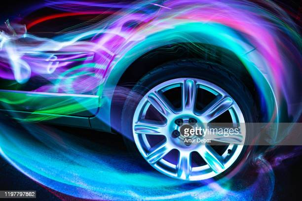 colorful aerodynamic light trails playing with the car shape at night. - hybrid car stock pictures, royalty-free photos & images