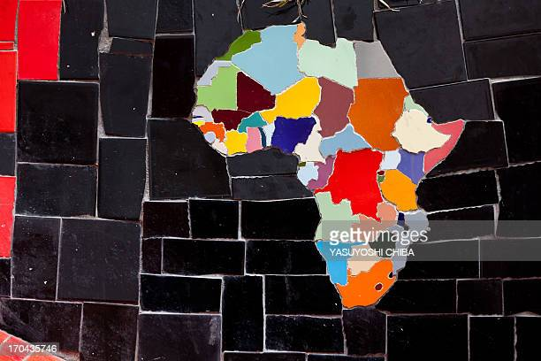 A colorful African map made out of tiles is seen on Escadaria Selaron stairway in Rio de Janeiro Brazil on October 9 2011 Chileanborn painter and...