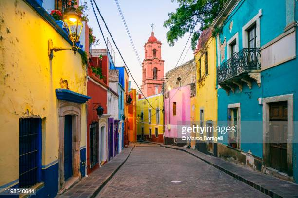colorful alley in guanajuato city, mexico - mexico stock pictures, royalty-free photos & images