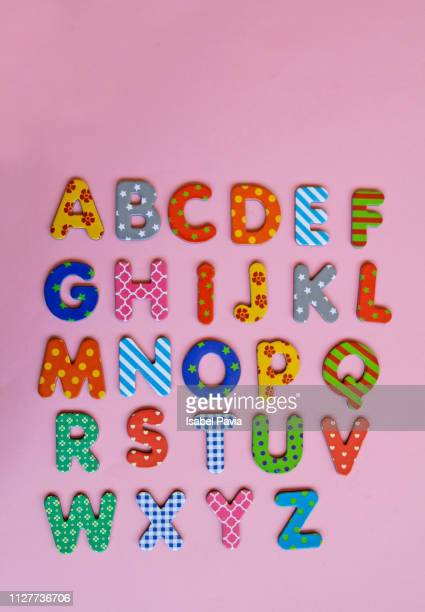 colorful alphabet on pink background - font photos et images de collection