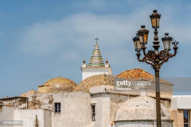 Colorful ancient rooftops of Parroquia de Santa Cruz in Cadiz, Spain