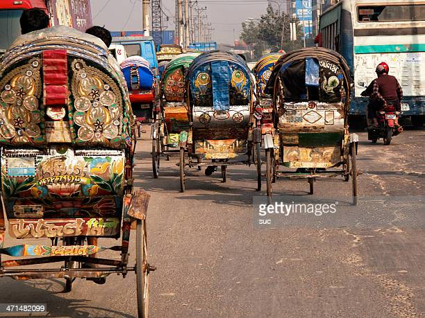 colorful and brightly decorated rickshaws in dhaka bangladesh capital - dhaka stock pictures, royalty-free photos & images