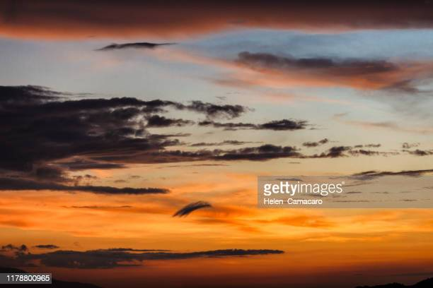 colorful  and dramatic clouds on sunset sky - light natural phenomenon stock photos and pictures