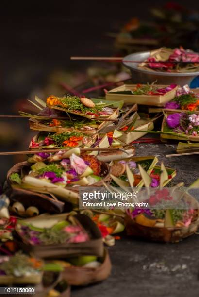 colorful and elaborate balinese hindu offerings. - balinese culture stock pictures, royalty-free photos & images