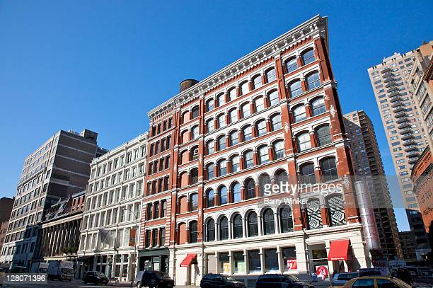 colorful and repetitive facade of office building on lafayette street, across from cooper union for the advancement of science and art, new york city, ny, usa - east village stock-fotos und bilder