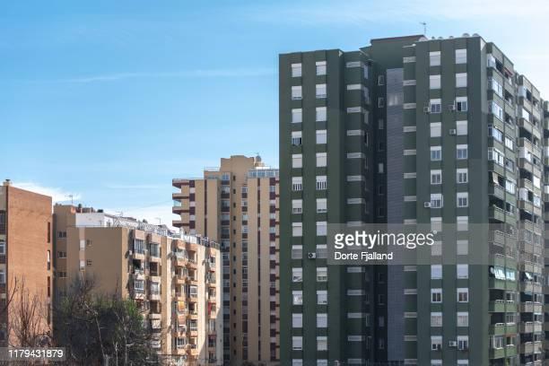 colorful apartment buildings against a blue sky on costa del sol - dorte fjalland bildbanksfoton och bilder